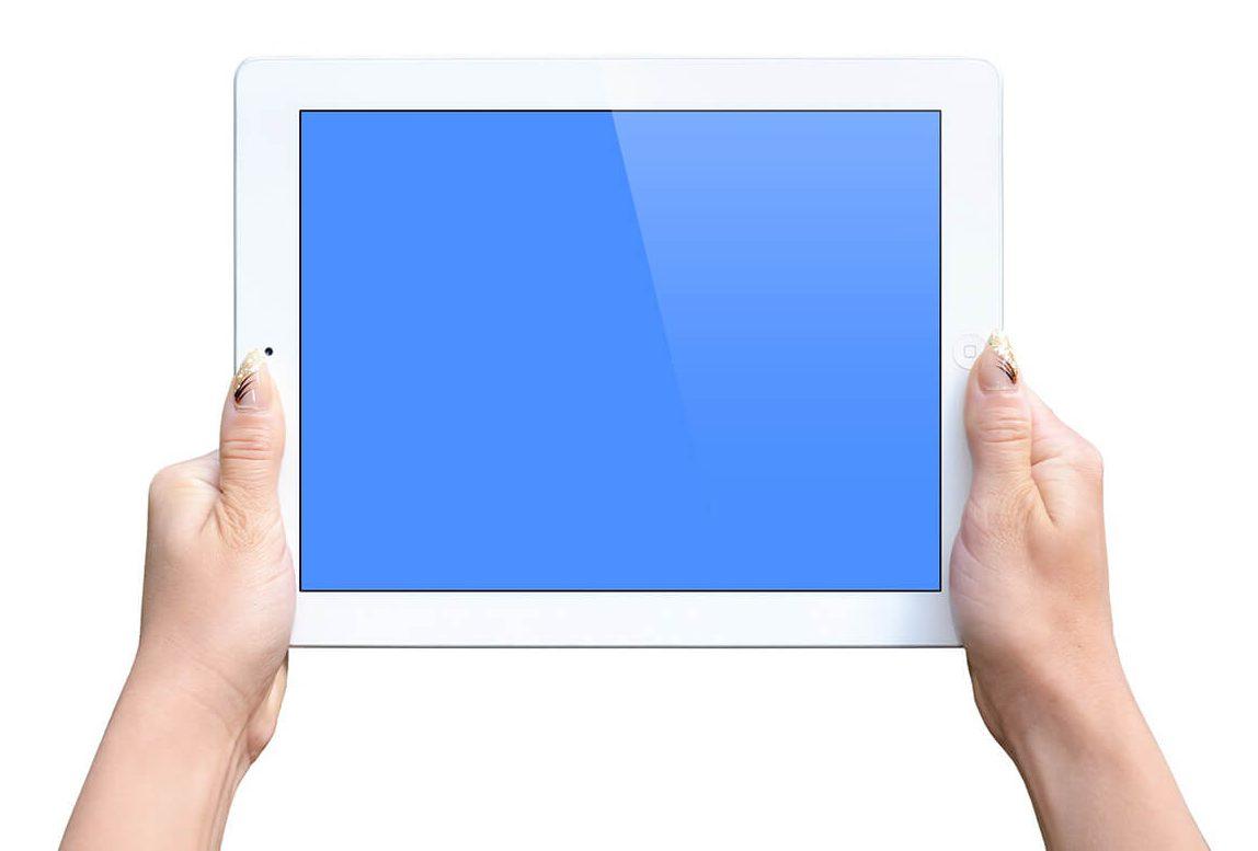 white-ipad-screen-in-female-hands-mockup-template-online-generator