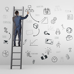 creative-businessman-sketch-ideas-planning-drawing-on-ladder-wall-prezi-templates